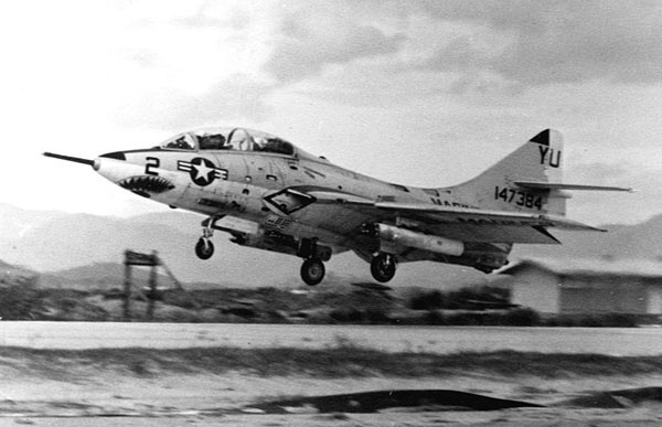 A TF-9J of H&MS-13 at Chu Lai, 1967. U.S. Marine Corps Grumman TF-9J Cougar (BuNo 147384) of Headquarters and Maintenance Squadron 13 (H&MS-13) at Chu Lai, Vietnam. H&MS-11 and H&MS-13 used the Cougar as a fast forward air control aircraft until being replaced by the Douglas TA-4F Skyhawk. This was the only combat use of the Cougar which was in service from 1952 to 1974.