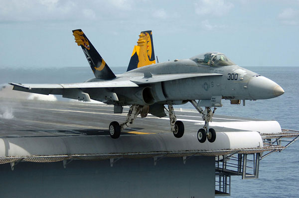 "Pacific Ocean (Aug. 17, 2005) – An F/A-18C Hornet, assigned to the ""Golden Dragons"" of Strike Fighter Squadron One Nine Two (VFA-192), launches from the flight deck of the conventionally powered aircraft carrier USS Kitty Hawk (CV 63)"