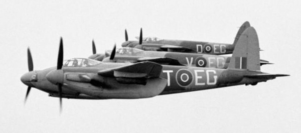 Three Mosquito FB Mark VIs of No. 487 Squadron RNZAF based at Hunsdon, Hertfordshire, flying in tight starboard echelon formation, with 500-lb MC bombs on underwing carriers