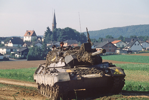 A Federal German Army Leopard 1 main battle tank of the 1st Platoon, 4th Company, 153rd Panzers, is parked in a field during the Confident Enterprise phase of REFORG-ER/AUTUMN FORGE '83 near Effolderbach (Hesse). Courtesy: CMSGT Don Sutherland, USAF